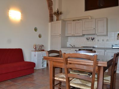 Photo for APARTMENT WITH PRIVATE GARDEN IN MEDIEVAL VILLAGE NEAR THE SEA,
