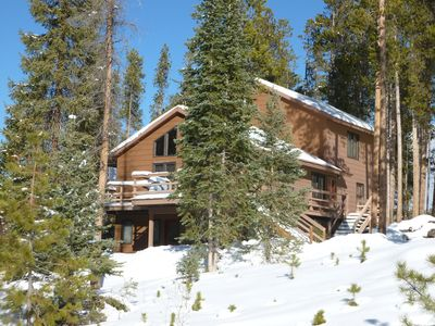 Front of House Nestled in the Pine Trees