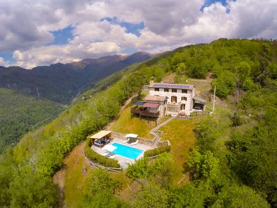 Photo for Stunning hilltop villa in Barga, Tuscany with private pool and spectacular views