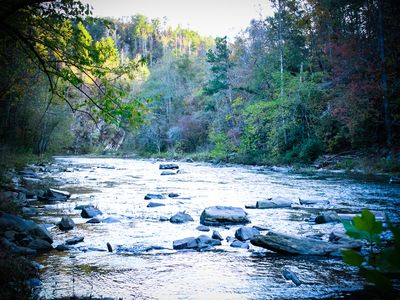 Photo for Riverfront pet friendly very private cabin sleeps 10 with hot tub and fire pit!
