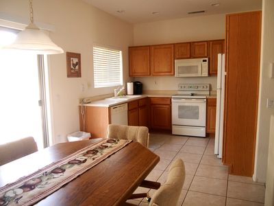Beautiful Wood Grain Kitchen with All the Appliances and Kitchen Ware