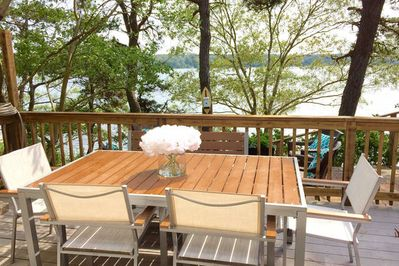Enjoy your meals on the waterfront Trex deck with charcoal Weber Grill