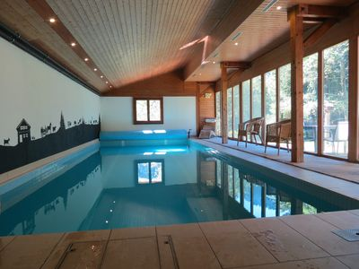 The 10m private heated pool with south-facing windows & doors to the garden.