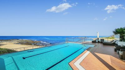 Photo for WAVES AT BLUE BAY, BLUE BAY - BEACHFRONT WITH POOL, OCEAN VIEWS, WIFI & FOXTEL