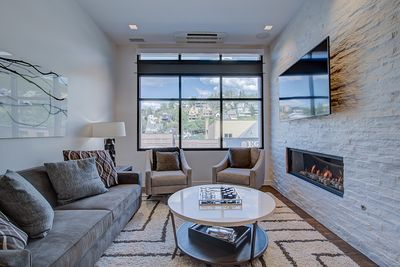 Living room showcases a gas fireplace and views of Main Street