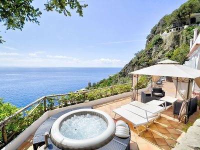 Photo for Appartamento Annarosa D: A characteristic apartment that covers the entire ground floor of a villa built on the sloping cliff in front of the sea, with Free WI-FI.