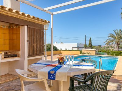 Photo for This 5-bedroom villa for up to 8 guests is located in Denia and has a private swimming pool, air-con