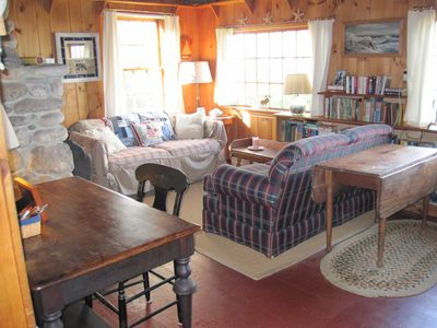 A truly authentic Maine cottage: pine walls, painted floors, and stone fireplace