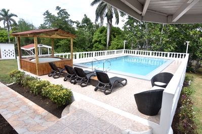 Clean swimming pool with Jacuzzi also BBQ hut to the left hand side of the pool
