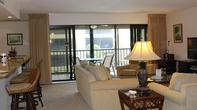 Photo for 2 bedroom condo, angle view to beach, renovated kitchen, pool, tennis, wireless internet
