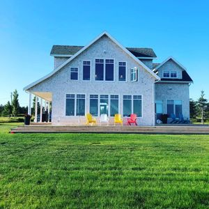 Photo for Gorgeous new ocean front beach house in popular Rustico and Brackley Beach