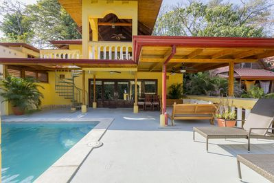 Casa Corona Main Level Entry- pool, dual loungers, daybed, and dining tables.