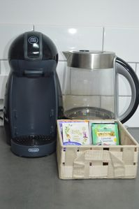 Dolce gusto coffee machine & pods are provided along with tea kettle & tea bags.
