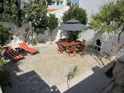 Photo for Quiet village house in the heart of Ferragudo, nice big patio, rooftop lounge!