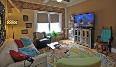 Living Room - The living room features a large flat-screen TV and cable service.