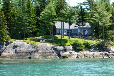 The 'Seaside Sanctuary' perched on granite coastline nestled in the trees