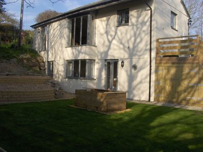 Rear garden with patio seating and BBQ area and chiminea
