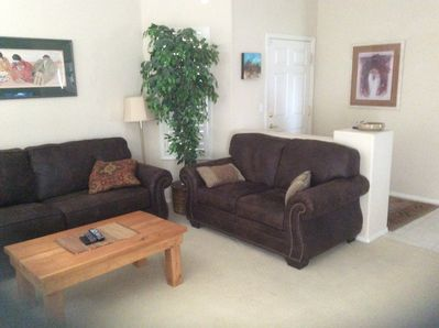 Comfy couches in living room...ideal open spacious floorplan