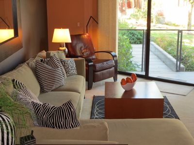 Photo for Stylish Riverfront Condo w/ river views in every room