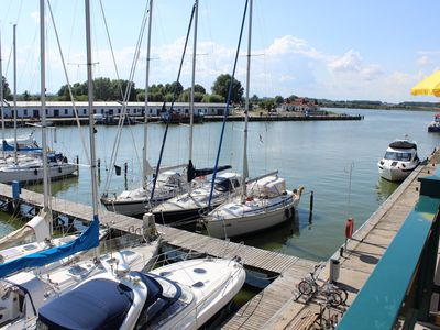 Photo for Sunny apartment with large balcony overlooking the marina