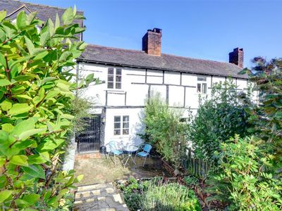 Photo for Dating from the late C17th, this romantic Grade II listed period cottage boasts loads of character a