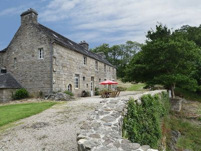 Photo for 14th century Breton manor, surrounded by rocks, near a small private bathing lake.