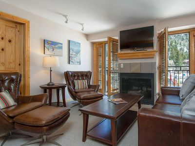 Photo for Summer Special! Spacious 2-bedroom condo 30 feet from Lift #1 with ski slope view and on-site hot tu