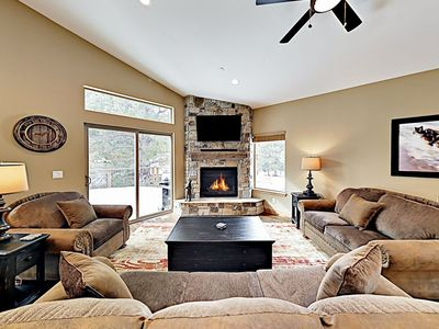 Great living room with cozy gas fire place and flat screen TV
