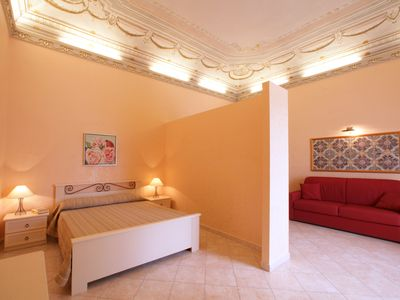 Photo for Elegant and comfortable, in the city center 2 steps from the sea with terrace and wifi