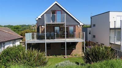 Photo for Lovely large, detached beach house with stunning sea views