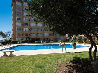 Photo for Lovely apartment for 5 people with A/C, pool, WIFI, TV and parking