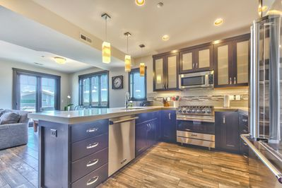Gourmet Display Kitchen with Viking Appliances and Bar Seating for 4