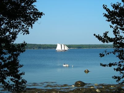 waterfront view of Eggemoggin  Reach at low tide with schooner