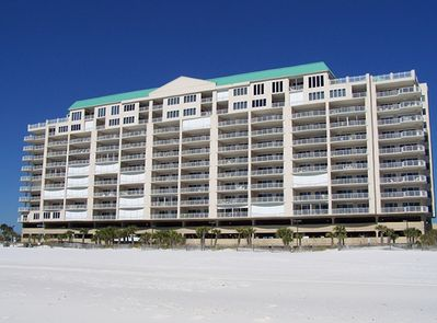 The condominium features balconies that are dead square with the beach.