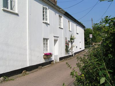 Front of cottage on quiet lane