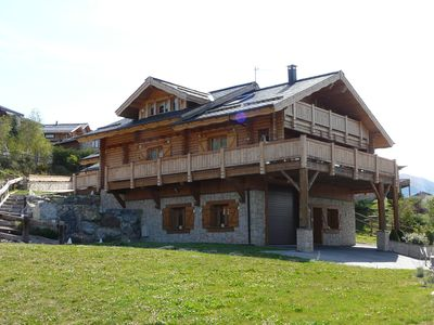 Photo for Very beautiful log cabin of prestige with a splendid view for 13 people