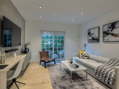Photo for Luxurious 2 Bedroom Apt with Lush Private Patio, on the Bay next to Lincoln Road