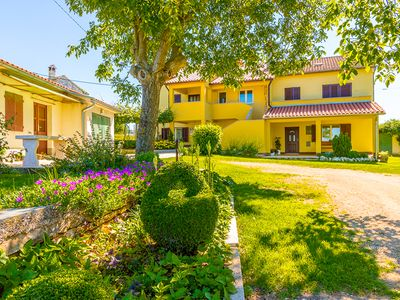 Photo for Holiday home surrounded by green nature with 3 bedrooms, 2 bathrooms, washing machine, air conditioning, WiFi, large garden and barbecue area