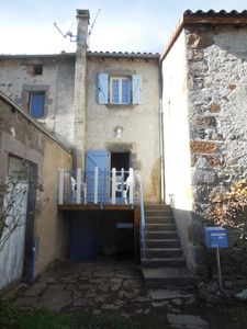 Photo for Charming cottage in old fortified village with its medieval bridge.