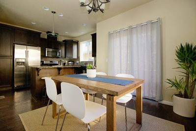 Spacious open dining and kitchen for you and your guests.