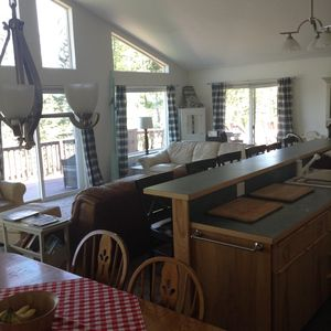 Dining room table seats 6 with 6 barstools in the open kitchen