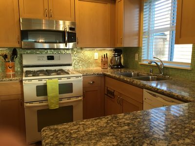Well Equipped Kitchen with Gas Range and Granite Countertops