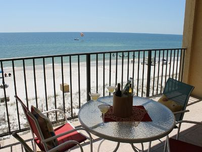 Large balcony directly overlooking the beach and pool. Gorgeous 4th floor view.