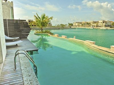 Photo for Incredible Water Front Apartment With Amazing Views And Infinity Pool !!