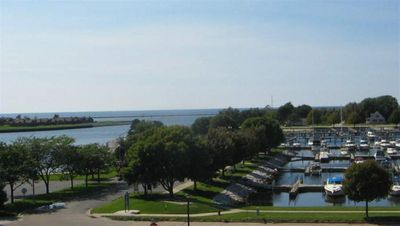 Amazing Marina & Lake MI Harbor views from this 3 Bed, 2 Bath Condo!