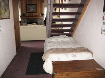 Single Bed under Stairs in Entry