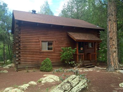 Photo for Cozy streamfront cabin nestled in the pines