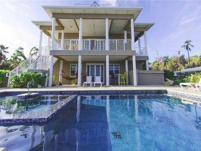 Photo for Our Cayman Cottage: Spacious Family Beach House with Pool, Spa, Kayaks, + Game Room