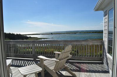 Enjoy the view from the deck with a book and a glass of wine!