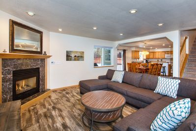 Living room with gas fireplace and a huge smart TV